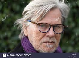 looking with grey hair portrait of a senior man outdoor with glasses grey hair small