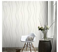 white walls with wallpaper accent wall