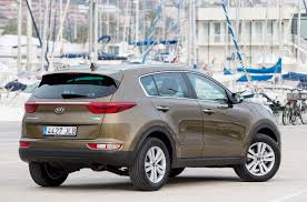 kia sportage review parkers