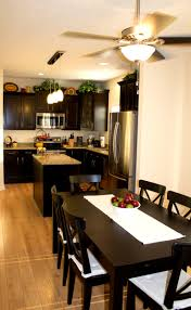 small espresso dining table espresso kitchen cabinets with stainless steel appliances kitchens