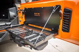 jeep tailgate storage springtail mpac jeep rear door folding tray