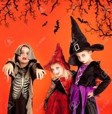 halloween children background halloween group of children girls costumes on orange background