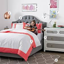 grey teenage room design with coral red accents