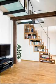 compact bookshelves built into the staircase home reviews