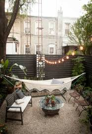 small backyard with string lights and hammock hang a hammock in