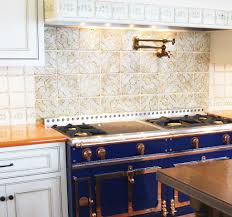 Ceramic Tile Backsplash Kitchen Orange Lavastone Counter With Blue French Range And Tabarka Tile