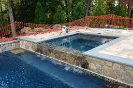 how much does it cost to install a tub near an existing pool
