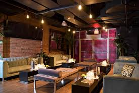 exposed brick wall lighting the loft features exposed brick walls couches and chaise lounges