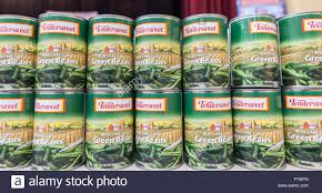 cans of green beans wait to be distributed at a thanksgiving dinner