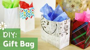 tutorial on how to make your own gift bag using newspaper