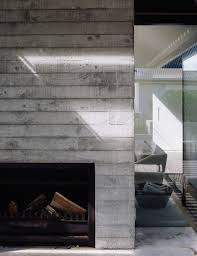 the concrete fireplace surround shows the marks from the rough