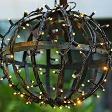 globe shaped outdoor lighting how to turn wire baskets into a fairy light globe plant basket