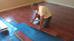 how to install wood laminate flooring on rubber floor tiles garage