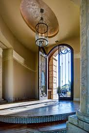 photos hgtv home entry and foyer with high ceiling wrought iron