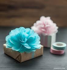 how to use tissue paper in a gift box diy tissue pom pom gift toppers