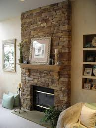 entrancing wooden mantel shelf in engaging stone veneer fireplace