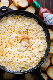 shrimp and artichoke casserole holiday shrimp artichoke dip video recipe natashaskitchen com