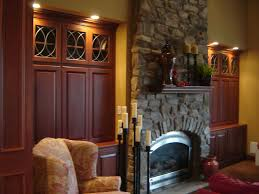 custom made cherry fireplace wall alcove cabinetry by odhner