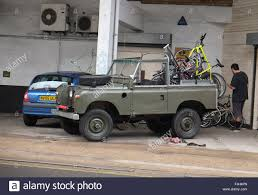 land rover old old open land rover loaded with bikes near evans bikes in bristol