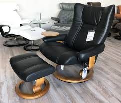 stressless wing paloma black leather recliner chair and ottoman by