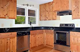 Knotty Pine Cabinets Kitchen A Small Kitchen Area With Knotty Pine Cabinets And Bamboo Floors
