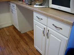 how to paint particle board cabinets question what of paint do you use on particle board
