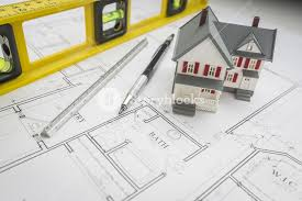 home construction plans model home construction level engineer pencil and ruler resting on