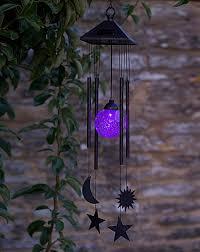 solar powered wind chime light sun moon and star solar light windchime j d williams