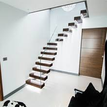 internal floating stairs with glass stair railings
