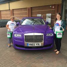 roll royce purple rolls royce motor cars manchester help to raise funds for francis