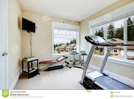 home gym with equipment weights and tv stock photography image