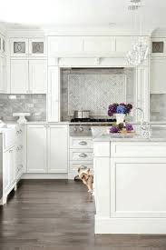 light grey brick tiles gray and white backsplash kitchen clear glass hanging light grey
