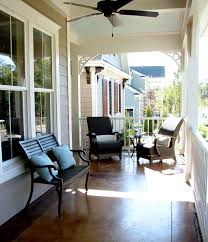 one story model home with a large front porch a front door with