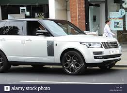 land rover skyfall new range rover cars on ontime transporter m40 motorway stock