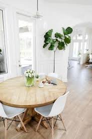 round table grand ave a rustic round wood table surrounded by white eames dining chairs