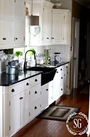 white kitchen cabinets soapstone countertops farmhouse kitchen stonegable