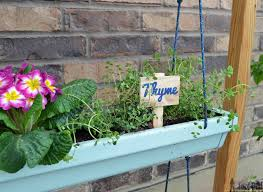 hanging gutter planter and stand her tool belt