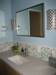 blue wall paint mirror with wooden frame backsplash tile gray