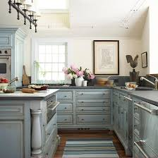 blue kitchen cabinets and yellow walls blue kitchen cabinets cottage kitchen bhg