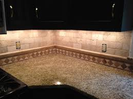 corner view of the custom tuscany classic backsplash using subway