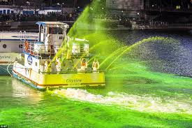 thousands gather to watch the chicago river turn green daily