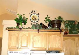 Kitchen Cabinet Decorating Ideas Above The Cabinet Decor Above Kitchen Cabinet Decor Ideas