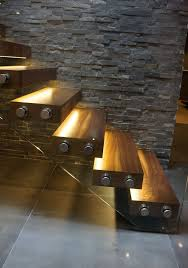 Staircase Design Inside Home by These Lighted Stairs Are Fixed In The Stone Wall On One Side And A