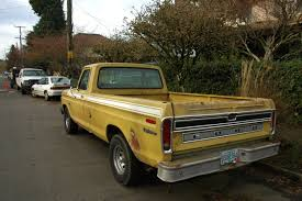 Ford F 150 Yellow Truck - old parked cars 1973 ford f150 explorer