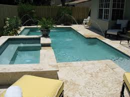 swimming pool light cream stone pool deck design combined with
