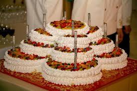 beautiful large multi tiered wedding cake of complex shape stock