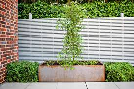 large garden using portland stone and steel planters in hampstead