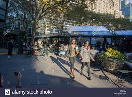 visitors to bryant park in new york enjoy the unseasonable warm