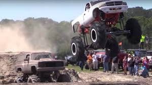 smart car lifted lifted trucks jump one another in ultimate u0027muddin u0027 entrance