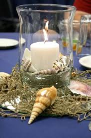 nautical centerpiece with and pillar candles wedding design